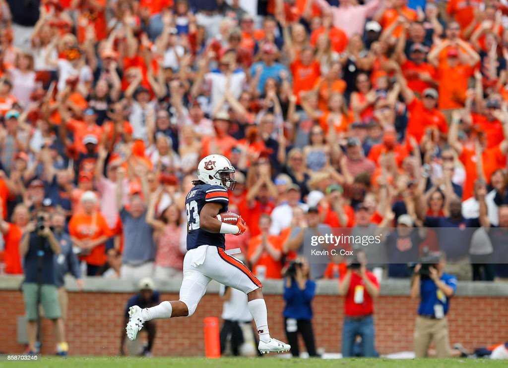 Ryan Davis #23 of the Auburn Tigers rushes for a touchdown against the Mississippi Rebels at Jordan Hare Stadium on October 7, 2017 in Auburn, Alabama.