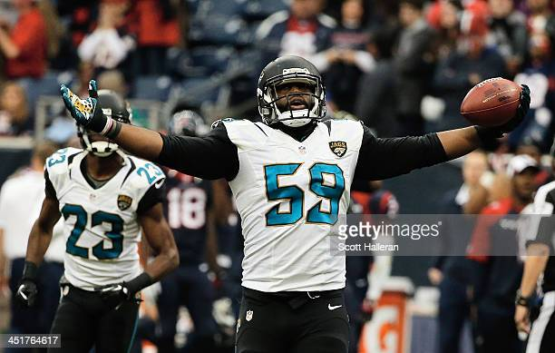 Ryan Davis of the Jacksonville Jaguars celebrates after intercepting a pass late in the fourth quarter of the game against the Houston Texans at...
