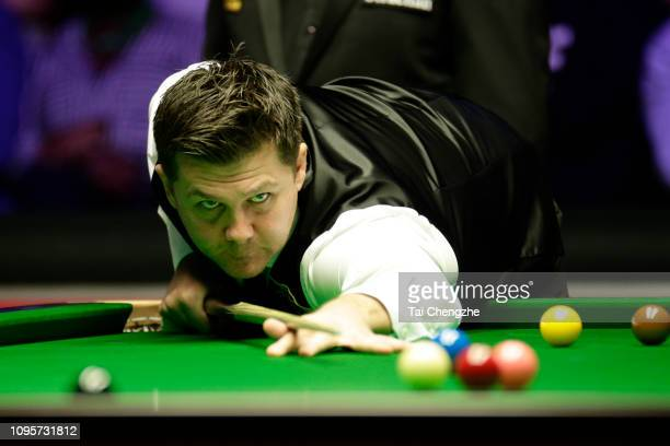Ryan Day of Wales plays a shot during his quarter-final match against Ronnie O'Sullivan of England on day five of the 2019 Dafabet Masters at...