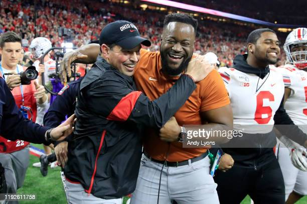 Ryan Day the head coach of the Ohio State Buckeyes celebrates with Ryan Stamper after the BIG Ten Football Championship game against the Wisconsin...