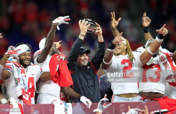 Ryan Day the head coach of the Ohio State Buckeyes holds the winner's trophy after the BIG Ten Football Championship game against the Wisconsin...