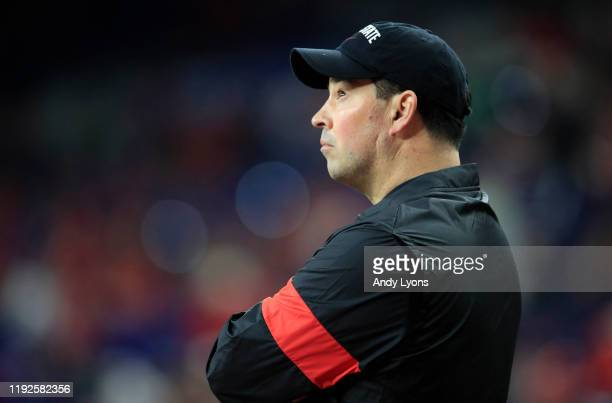 Ryan Day the head coach of the Ohio State Buckeyes watches his team practice before the start of the BIG Ten Football Championship game against the...