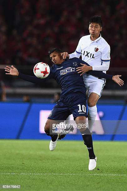 Ryan De Vries of Auckland City competes for the ball against Hwang Seok Ho of Kashima Antlers during the FIFA Club World Cup Playoff for Quarter...