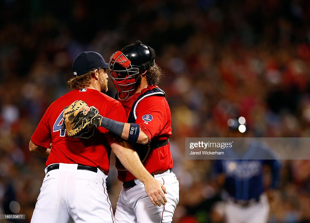 Ryan Dempster #46 and Jarrod Saltalamacchia #39 of the Boston Red Sox hug after defeating the Tampa Bay Rays 12-2 in Game One of the American League Division Series at Fenway Park on October 4, 2013 in Boston, Massachusetts.