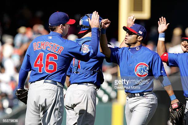 Ryan Dempster of the Chicago Cubs is congratulated after striking out JT Snow of the San Francisco Giants to end the game at SBC Park on September 11...