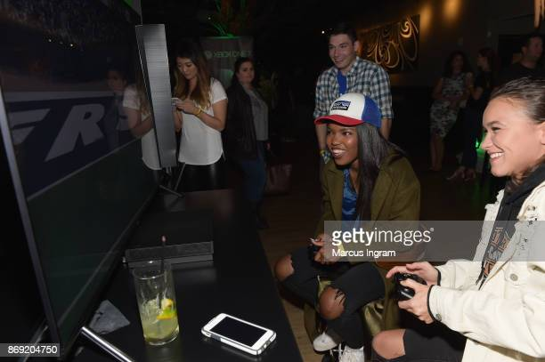 Ryan Destiny and guest attend the Xbox One X Launch Event at 5Church on November 1 2017 in Atlanta Georgia