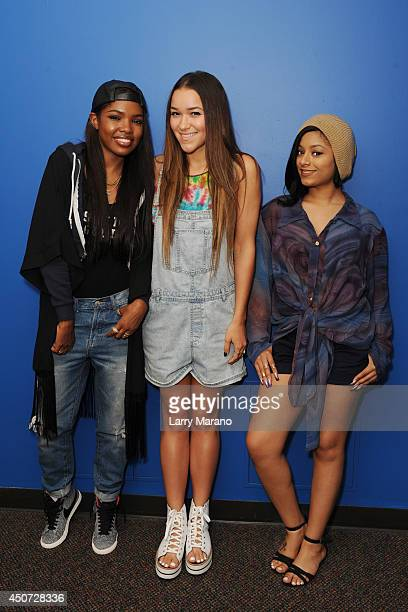 Ryan Destiny Chelsea Stone and Jasmine of Love Dollhouse pose for a portrait at Y 100 Radio Station on June 16 2014 in Miami Florida