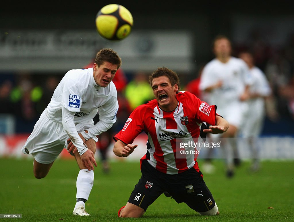 Ryan Dickson of Brentford is fouled by Charlie Henry of Havant & Waterlooville during the FA Cup 1st Round match between Havant & Waterlooville and Brentford at the Westleigh Park on November 9, 2008 in Havant, England.