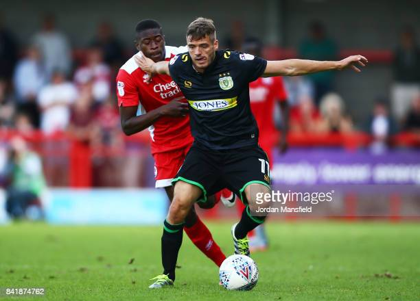 Ryan Dickson of Yeovil Town tackles with Ibrahim Meite of Crawley Town during the Sky Bet League Two match between Crawley Town and Yeovil Town at...