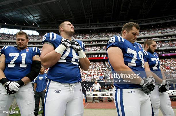 Ryan Diem Joe Reitz Mike Pollak and Jeff Linkenbach of the Indianapolis Colts pause for a moment of silence before the Colts played against the...