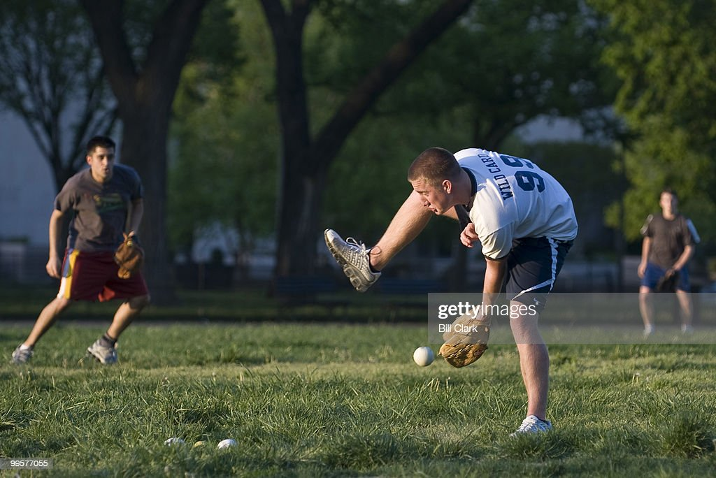 Ryan Dillon, of Rep. Ike Skelton's office, tries to catch and dodge a sharply hit ball during the Show Me Asses softball team practice on the National Mall on Monday, April 27, 2009.