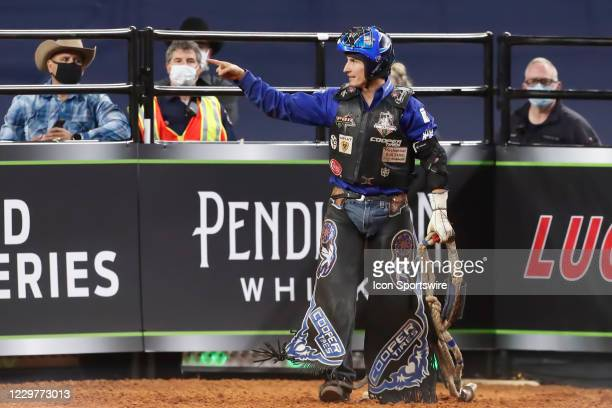 Ryan Dirteater celebrates following his ride of bull Smooth Operator during the PBR World Finals, on November 15th at the AT&T Stadium, Arlington, TX.
