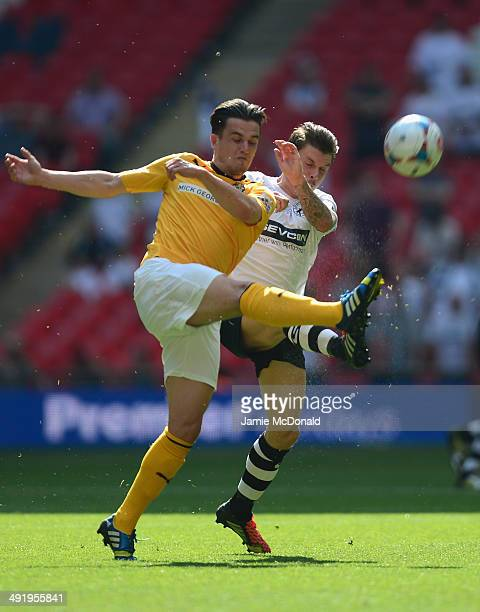 Ryan Donaldson of Cambridge United battles with John Oster of Gateshead United during the Skrill Conference Premier PlayOffs Final between Cambridge...