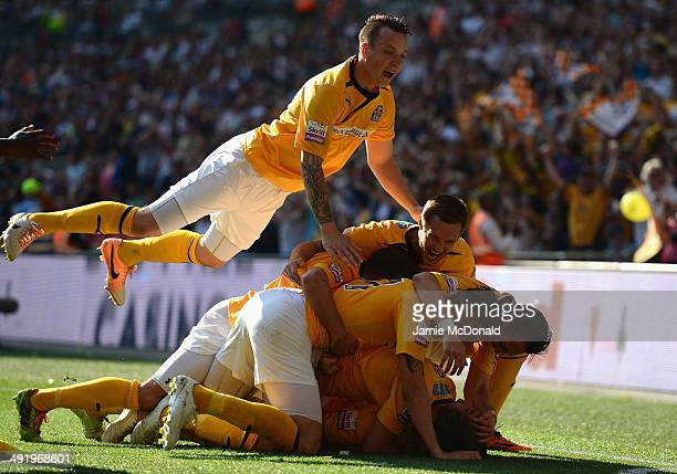 Ryan Donaldson of Cambridge United celebrates his goal with team mates during the Skrill Conference Premier PlayOffs Final between Cambridge United...