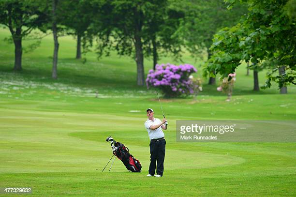 Ryan Donaldson of Portlethen Golf Club plays his approach shot to the 15th green during the Lombard Trophy - Scottish Qualifier at Crieff Golf Club...