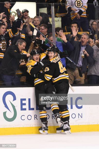 Ryan Donato and Danton Heinen of the Boston Bruins celebrate Ryan's first NHL goal against the Columbus Blue Jackets at the TD Garden on March 19...