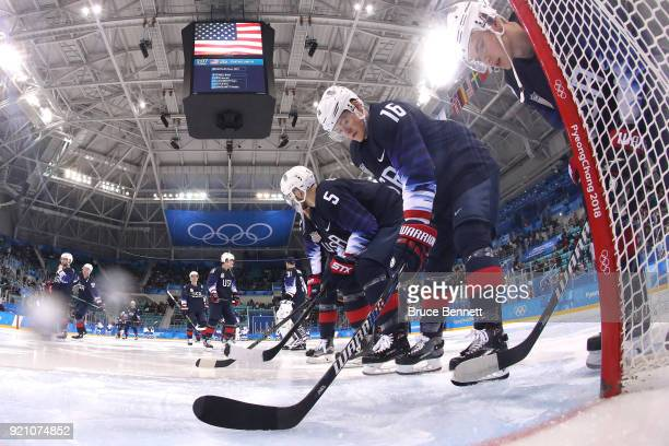 Ryan Donato and Noah Welch of the United States huddle up before their Men's Playoffs Qualifications game against Slovakia on day eleven of the...