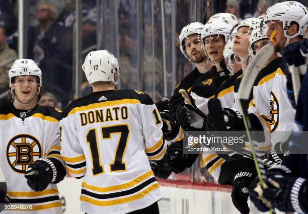 Ryan Donato of the Boston Bruins celebrates his first period goal against the Winnipeg Jets with teammates at the bench at the Bell MTS Place on...