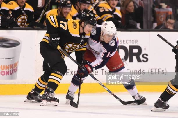 Ryan Donato of the Boston Bruins faces off against Matt Calvert of the Columbus Blue Jackets at the TD Garden on March 19 2018 in Boston Massachusetts