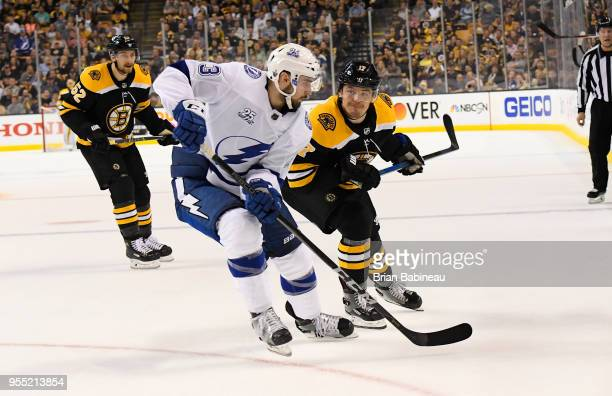 Ryan Donato of the Boston Bruins fights for position against the Tampa Bay Lightning in Game Four of the Eastern Conference Second Round during the...