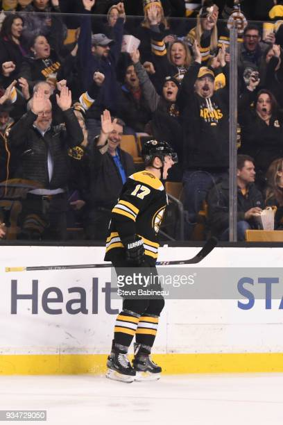 Ryan Donato of the Boston Bruins scores his first NHL goal against the Columbus Blue Jackets at the TD Garden on March 19 2018 in Boston Massachusetts