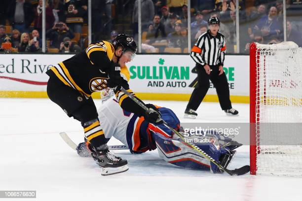 Ryan Donato of the Boston Bruins scores the gamewinning goal during the shootout against Robin Lehner of the New York Islanders to win the game 21 at...