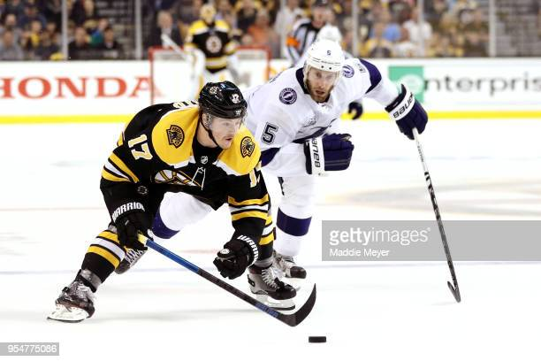 Ryan Donato of the Boston Bruins skates against Dan Girardi of the Tampa Bay Lightning during the third period of Game Four of the Eastern Conference...