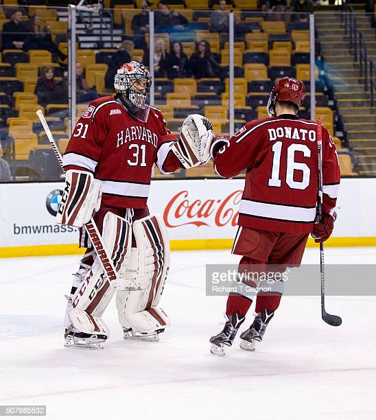 Ryan Donato of the Harvard Crimson celebrates his first period goal with teammate Merrick Madsen NCAA hockey against the Boston College Eagles in the...