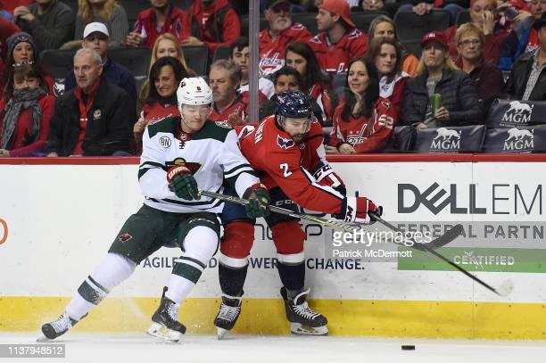 Ryan Donato of the Minnesota Wild and Matt Niskanen of the Washington Capitals battle for the puck in the first period at Capital One Arena on March...