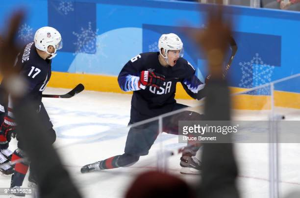 Ryan Donato of the United States and Chris Bourque of the United States celebrate after Donato scores against Slovakia during the Men's Ice Hockey...