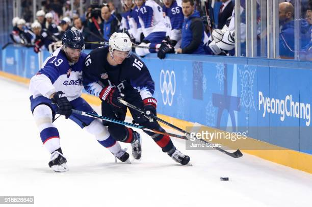 Ryan Donato of the United States and Tomas Starosta of Slovakia go for the puck during the Men's Ice Hockey Preliminary Round Group B game at...