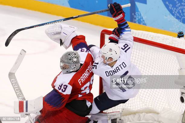 Ryan Donato of the United States attempts a shot on Pavel Francouz of the Czech Republic as they collide in overtime during the Men's Playoffs...
