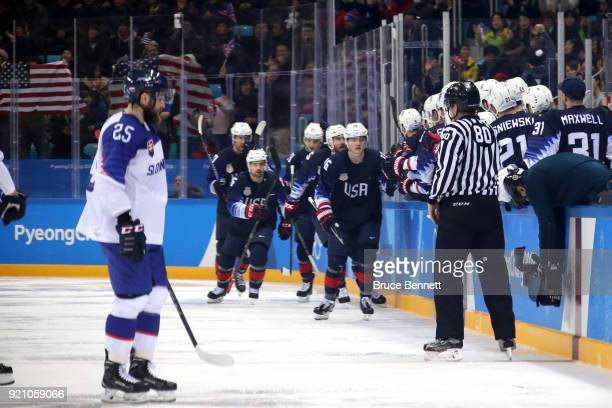 Ryan Donato of the United States celebrates with his teammates after scoring a goal against Jan Laco of Slovakia in the second period during the...
