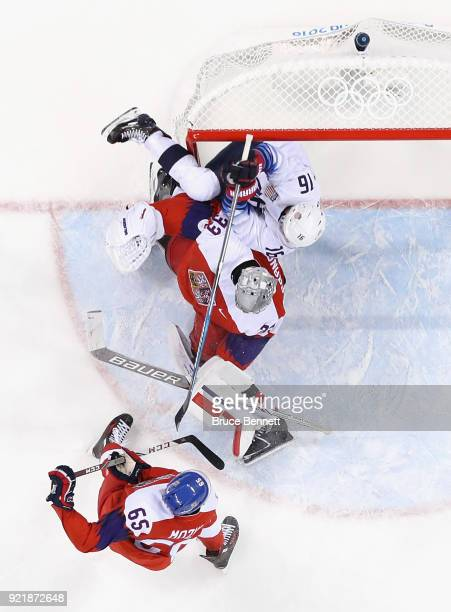 Ryan Donato of the United States falls over Pavel Francouz of the Czech Republic into the Czech Republic goal in the third period during the Men's...