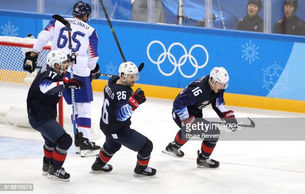 Ryan Donato of the United States Mark Arcobello of the United States and Chris Bourque of the United States celebrate after Donato scores against...