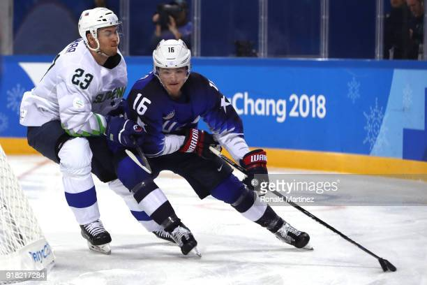 Ryan Donato of the United States skates against Luka Vidmar of Slovenia during the Men's Ice Hockey Preliminary Round Group B game on day five of the...