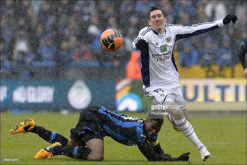 Ryan Donk of Club Brugge KV battles for the ball with Sacha Kljestan of RSC Anderlecht during the Jupiler League match between Club Brugge and RSC Anderlecht on February 24, 2013 in the Jan Breydel Stadium in Brugge, Belgium.