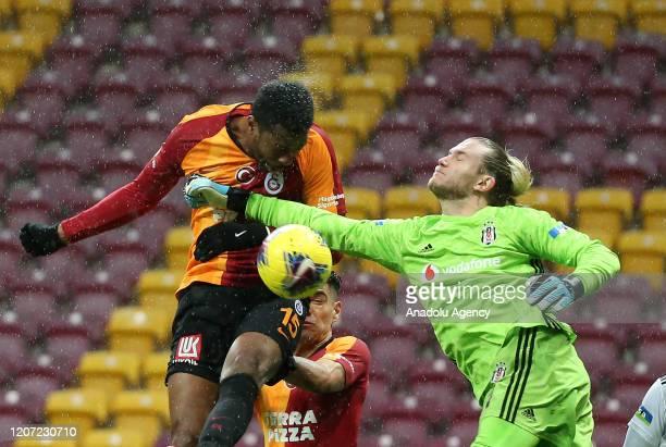 Ryan Donk of Galatasaray in action against goalkeeper Loris Karius of Besiktas during the Turkish Super Lig week 26 football match between...