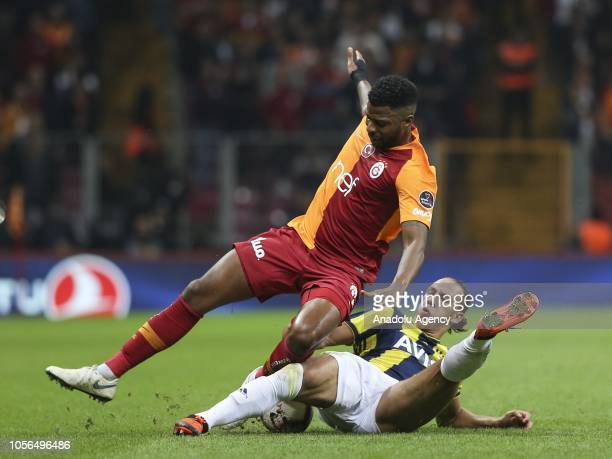 Ryan Donk of Galatasaray vies for the ball against Michael Frey of Fenerbahce during Turkish Super Lig soccer match between Galatasaray and...