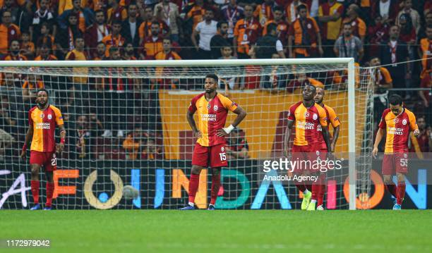 Ryan Donk Seri Marcao and Nagatomo of Galatasaray reacts after conceding a goal during the UEFA Champions League group A match between Galatasaray...