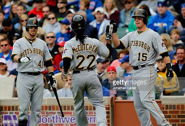Ryan Doumit and Andy LaRoche of the Pittsburgh Pirates greet teammate Andrew McCutchen after McCutchen scored a run in the 1st inning against the...
