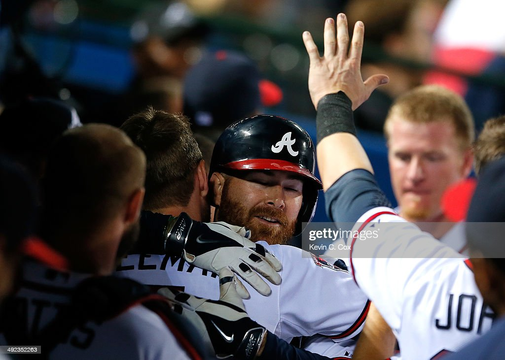 Ryan Doumit #4 of the Atlanta Braves hugs Freddie Freeman #5 after hitting a solo homer in the eighth inning against the Milwaukee Brewers at Turner Field on May 19, 2014 in Atlanta, Georgia.