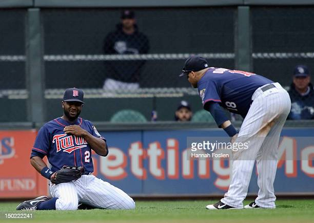 Ryan Doumit of the Minnesota Twins checks on Denard Span of the Minnesota Twins after Span hurt his shoulder on a play during the sixth inning...