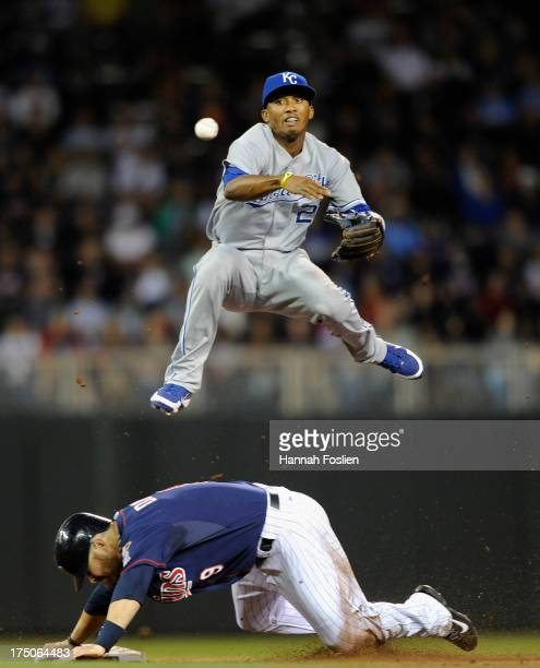 Ryan Doumit of the Minnesota Twins is out at second base as Alcides Escobar of the Kansas City Royals attempts to complete a double play during the...