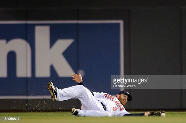 Ryan Doumit of the Minnesota Twins misses a catch an an RBI single off the bat Mike Aviles of the Cleveland Indians during the fifth inning of the...
