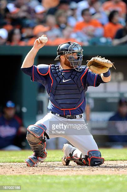 Ryan Doumit of the Minnesota Twins throws the ball to second base against the Baltimore Orioles during the home opener at Oriole Park at Camden Yards...