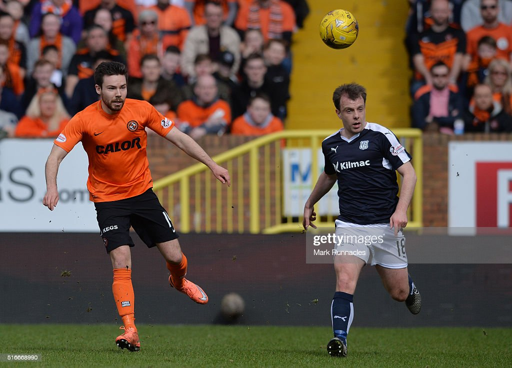 Ryan Dow of Dundee United is challenged by Paul McGowan of Dundee during the Ladbrokes Scottish Premiership match between Dundee United FC and Dundee FC at Tannadice Park on March 20, 2016 in Dundee, Scotland.