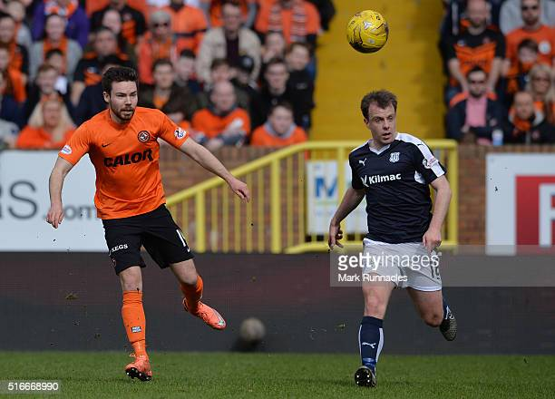 Ryan Dow of Dundee United is challenged by Paul McGowan of Dundee during the Ladbrokes Scottish Premiership match between Dundee United FC and Dundee...