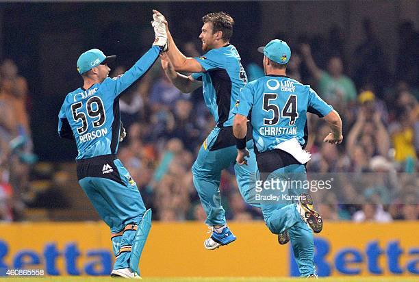 Ryan Duffield of the Heat celebrates after taking the wicket of Glenn Maxwell of the Stars during the Big Bash League match between the Brisbane Heat...