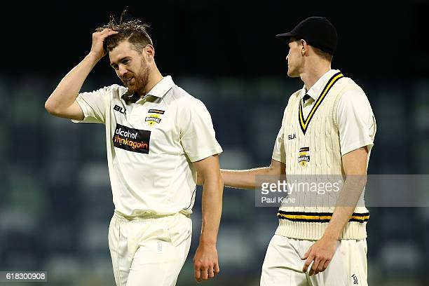 Ryan Duffield of the Warriors walks back to his bowling mark with Jason Behrendorff during day two of the Sheffield Shield match between Western...